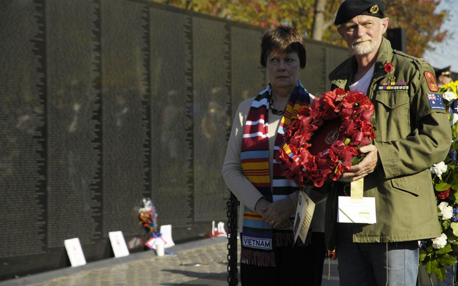 Visitors to the Vietnam Veterans Memorial on Nov. 11, 2012 pay tribute to those killed in the war during a wreath-laying ceremony.