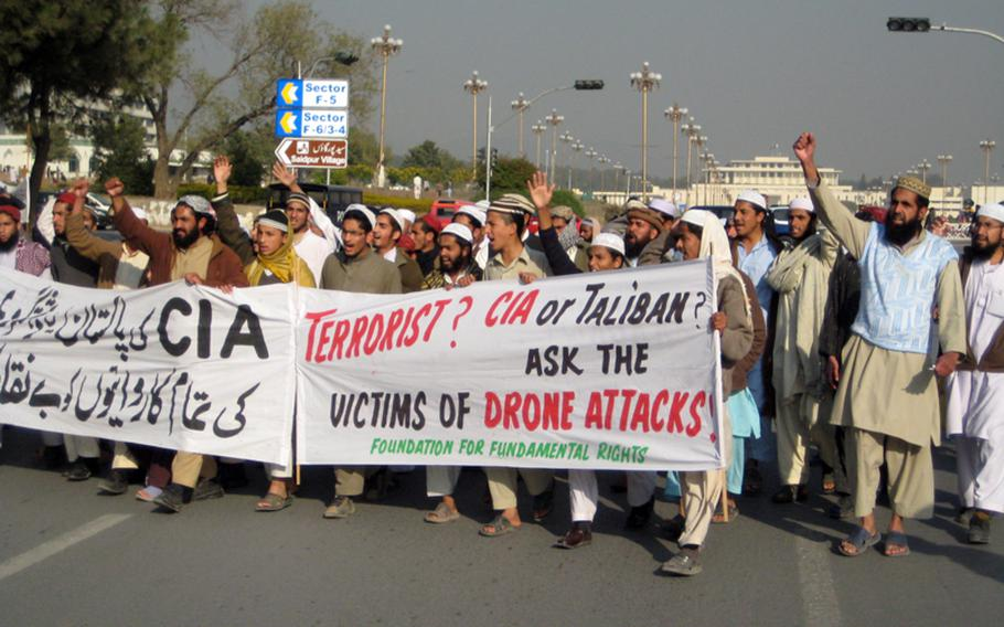 Demonstrators against CIA-operated American drone strikes in Pakistan march along the main thoroughfare in Islamabad, Jinnah Avenue, December 10, 2010. The presidential palace can be seen in the background.