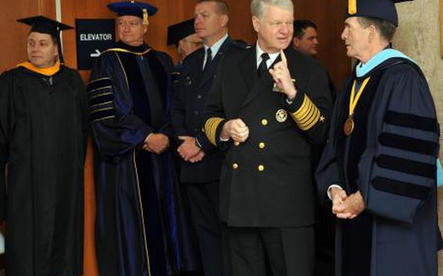 Dan Oliver (far right), president of the Naval Postgraduate School, talks with former Chief of Naval Operations Adm. Gary Roughead at a 2011 graduation. Oliver, a retired vice admiral, and an associate have been relieved of duty after an investigation found evidence of mismanagement.