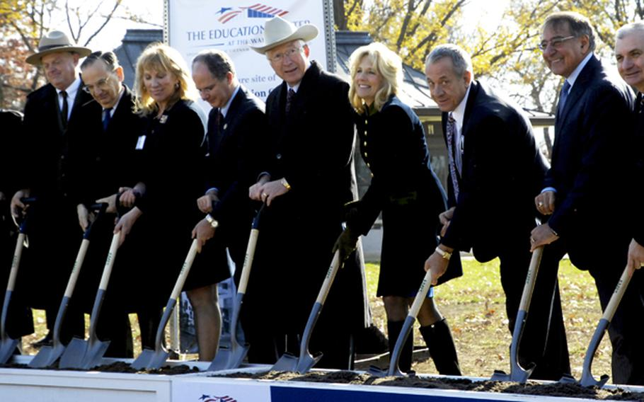 Secretary of Defense Leon Panetta, Dr. Jill Biden and other dignitaries break ground for the Education Center at the Wall in Washington, D.C., November 28, 2012.