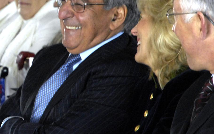 Secretary of Defense Leon Panetta talks with Dr. Jill Biden during the groundbreaking ceremony for the Education Center at the Wall in Washington, D.C., on November 28, 2012.
