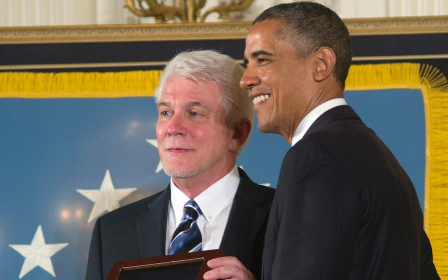 Ray Kapaun poses with President Barack Obama after receiving the Medal of Honor on behalf of his uncle, Father Emil Kapaun.