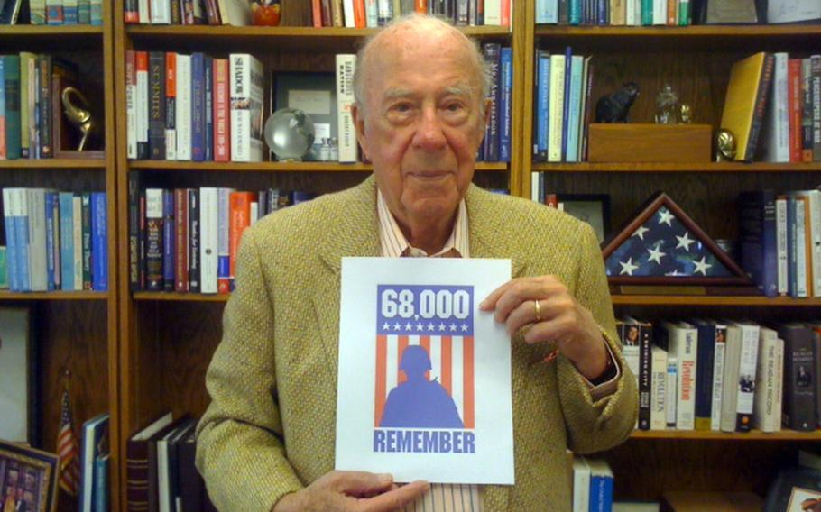 Former Secretary of State George Shultz poses for a ''68,000 Remember'' photo.