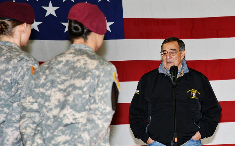 Secretary of Defense Leon Panetta visits with soldiers of U.S. Army Europe's 173rd Airborne Brigade Combat Team at Caserma Ederle in Vicenza, Italy, Jan. 17, 2013.