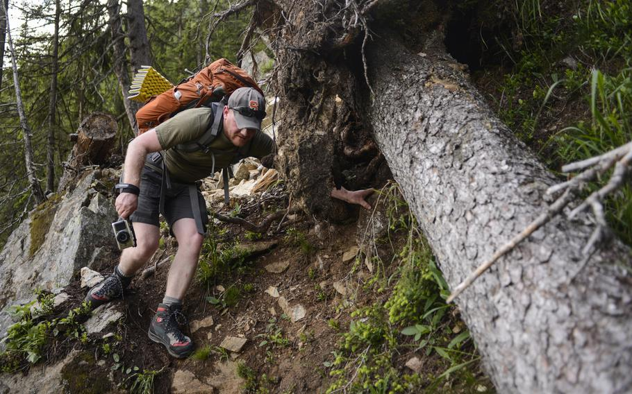 Matt Millham, a Stars and Stripes reporter, navigates a torn out piece of trail during an overnight hiking trip in Chamonix, France.