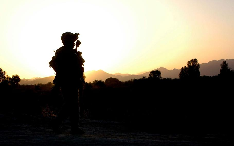 A soldier on patrol as the sun rises in the Sangin Valley of southern Afghanistan in this May 2004 photo. The Sangin Valley is one of the heaviest poppy-producing regions in the world and has a reputation as a drug lord, Taliban and al-Qaida stronghold, making it one of the most dangerous places for U.S. and coalition forces in Afghanistan.