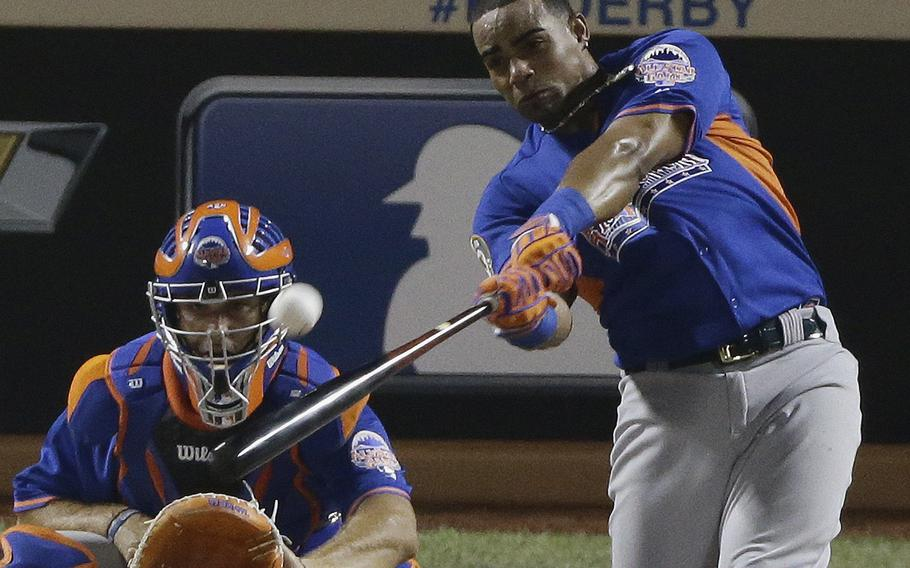 American League's Yoenis Cespedes of the Oakland Athletics hits during the final round of the MLB All-Star baseball Home Run Derby, Monday, July 15, 2013, in New York. (AP Photo/Frank Franklin II)