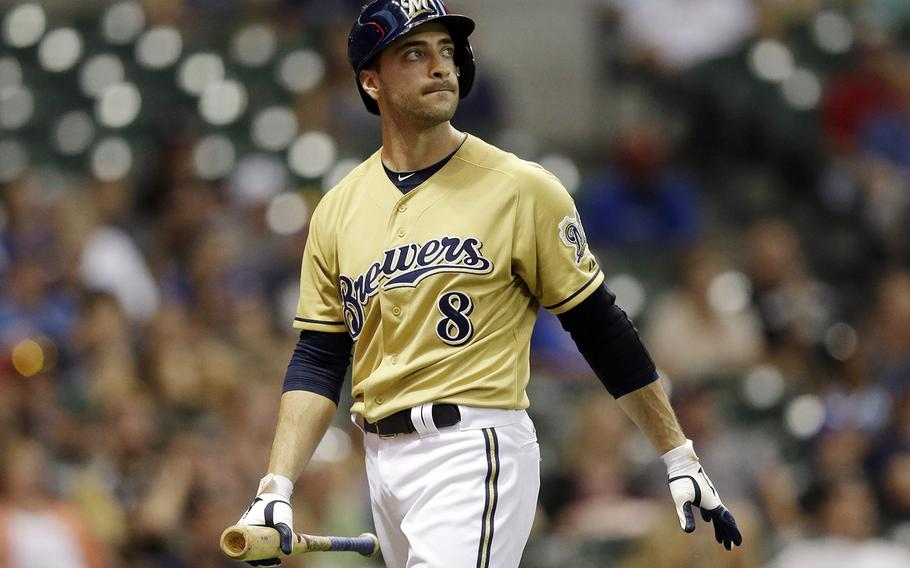 """Milwaukee Brewers' Ryan Braun reacts after striking out after pinch hitting during the 11th inning of a baseball game against the Miami Marlins on July 21, in Milwaukee. Braun, the 2011 National League MVP, has been suspended without pay for the rest of the season and admitted he """"made mistakes"""" in violating Major League Baseball's drug policies. MLB Commissioner Bud Selig announced the penalty Monday and released a statement by the Milwaukee Brewers slugger, who said: """"I am not perfect. I realize now that I have made some mistakes. I am willing to accept the consequences of those actions."""" (AP Photo/Morry Gash)"""