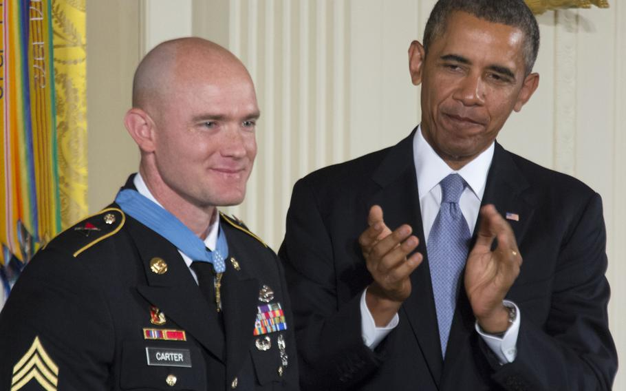 President Barack Obama leads the applause for Army Staff Sgt. Ty Carter after presenting him with the Medal of Honor Monday, August 26, 2013 at the White House.