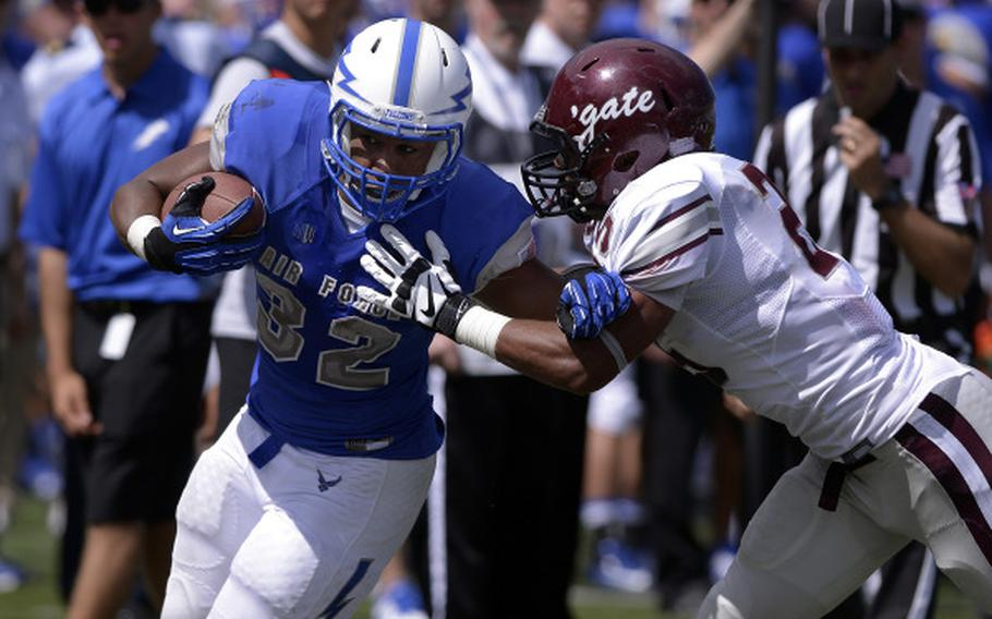 Junior Air Force running back Broam Hart tries to elude a Colgate defender during his team's 38-13 home win Aug. 31, 2013. Hart had 101 yards and two touchdowns in the game.