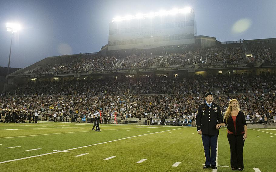 Army Staff Sgt. Ty Carter and his wife, Shannon, are honored during the home football game at West Point on Aug. 30, 2013. Four days earlier, Carter became one of only eight men to receive the Medal of Honor for exemplary heroism in the Afghanistan War.