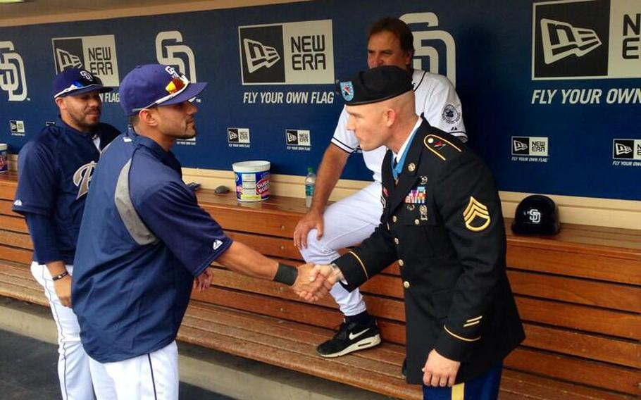 Exactly one week after receiving the Medal of Honor from President Obama, Army Staff Sgt. Ty Carter was shaking hands with San Diego Padres baseball players at Petco Park, where he threw out the ceremonial first pitch on Labor Day, 2013.