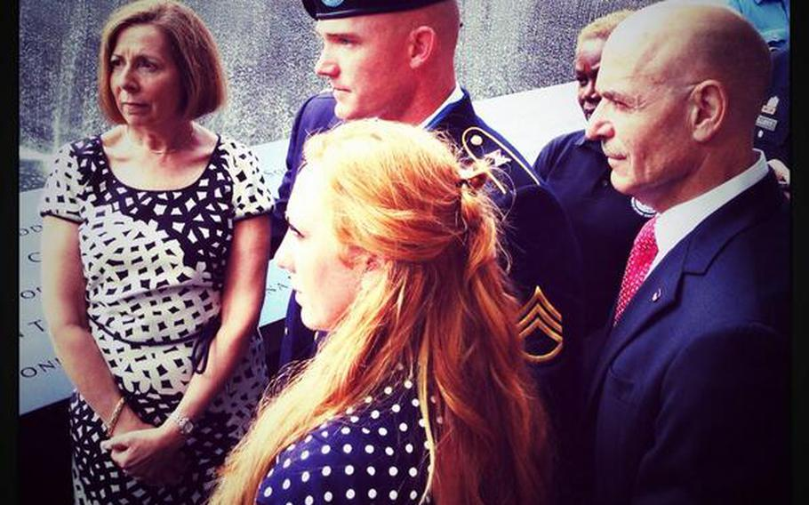 Army Staff Sgt. Ty Carter and his wife, Shannon, both middle, are escorted on a tour of the 9/11 Memorial with museum director Alice Greenwald, left, and FDNY Commissioner Sal Cassano, right, Aug. 29, 2013.