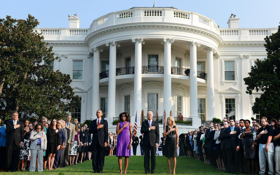 President Barack Obama, first lady Michelle Obama, Vice President Joe Biden and Dr. Jill Biden observe a moment of silence with White House staff to mark the 12th anniversary of the 9/11 attacks, Wednesday, September 11, 2013 at the South Lawn of the White House in Washington, D.C.