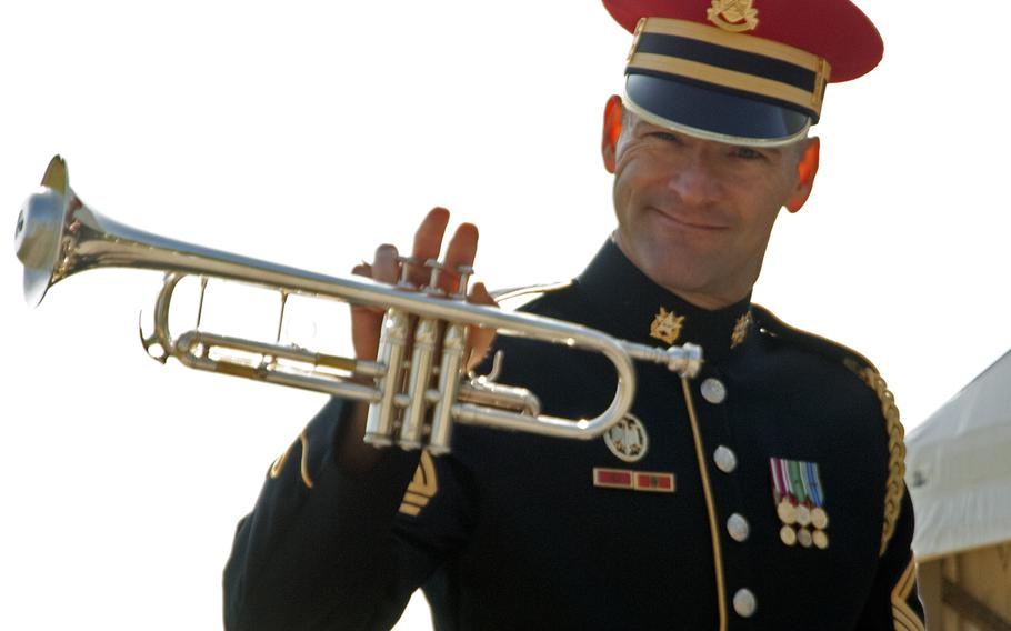 A musician smiles for the camera as he walks to the stage for the annual Medal of Honor Society convention, held this year at the Eisenhower House.