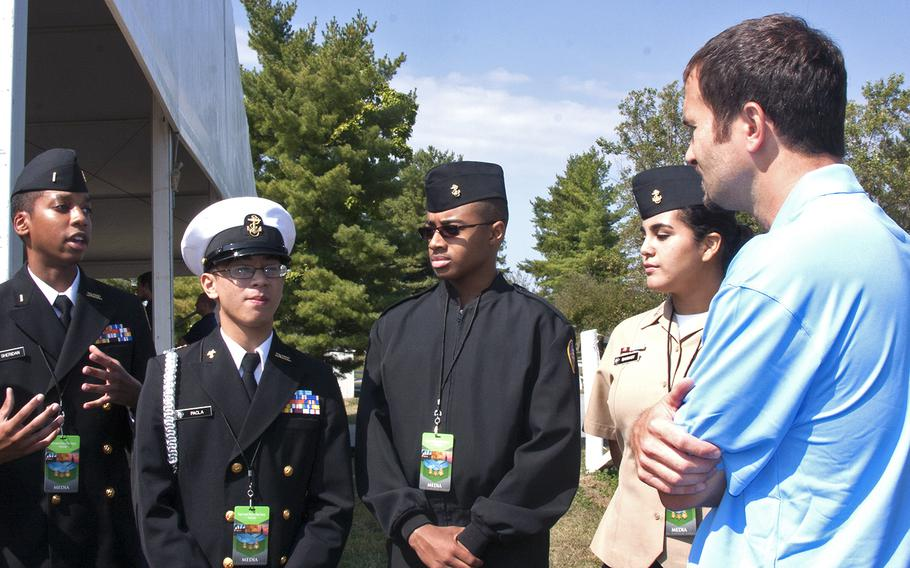 Medal of Honor recipient Salvatore Giunta speaks with Navy JROTC members from North Plainfield High School during the Medal of Honor Society's annual convention on Sept. 19, 2013.