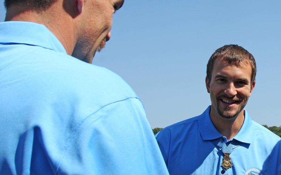 Clinton Romesha, left, takes a moment to chat with fellow Medal of Honor recipient Salvatore Giunta on Sept. 19, 2013.