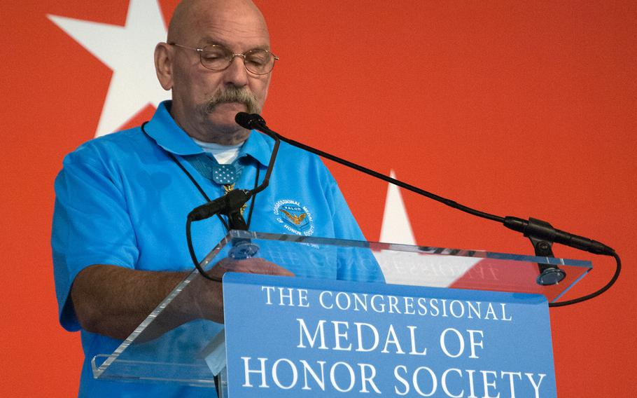 A Medal of Honor recipient talks to the crowd at the annual convention of the Medal of Honor Society on Sept. 19, 2013.