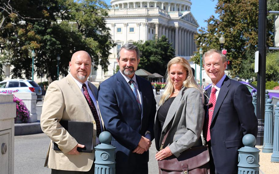 Defense Department overseas employees, from left, Cliff Elrod, Peter McCollaum, Joni Thomas and Steve Ewell, were on Capitol Hill last week asking lawmakers to intervene in an ongoing dispute over housing allowance pay from the DOD to overseas employees.