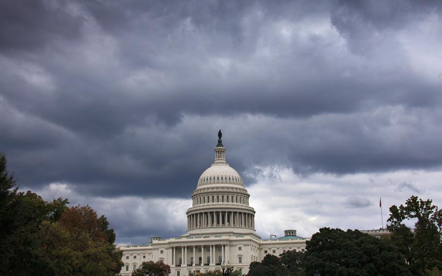 Dark clouds hang over the U.S. Capitol in Washington on Saturday, Sept. 28, 2013.