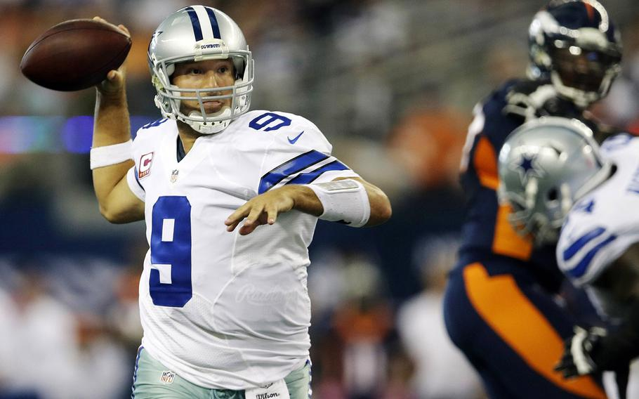 Dallas Cowboys quarterback Tony Romo rolls out to pass against the Denver Broncos during the fourth quarter Sunday in Arlington, Texas. Romo  was 25-for-36 for 506 yards and five touchdowns for Dallas (2-3), breaking Don Meredith's franchise record of 460 yards. He is the fifth quarterback in NFL history to pass for at least 500 yards and five touchdowns in a game, but his late interception set up Denver's game-winning field goal.