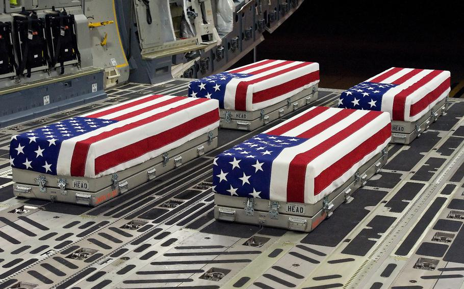 The remains of four soldiers await transfer at Dover Air Force Base, Del., Jan. 8, 2012.