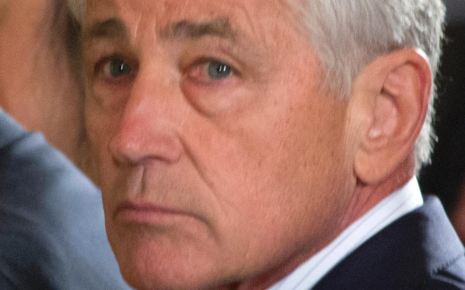 Defense Secretary Chuck Hagel attends the ceremony of William Swenson receiving the Medal of Honor on Tuesday, October 15, 2013.