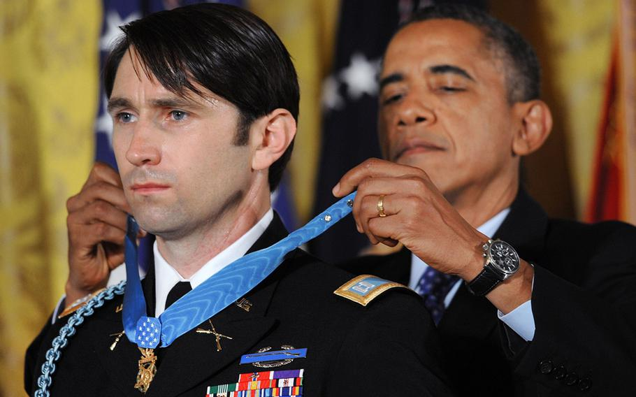 U.S. Army Capt. William Swenson is awarded the Medal of Honor by President Barack Obama on Tuesday, October 15, 2013, at the White House in Washington, DC.