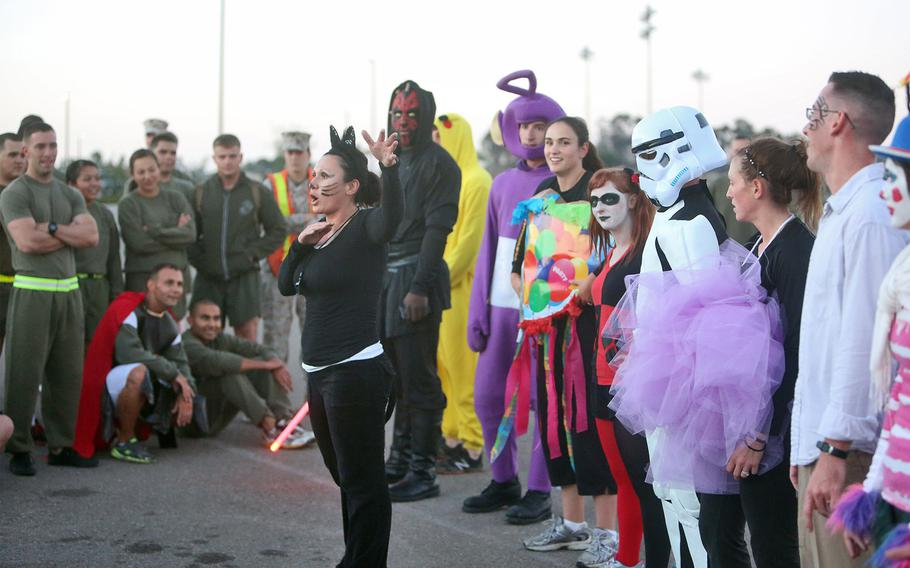 Gunnery Sgt. Joanna H. Mendoza, Headquarters Company gunnery sergeant, Combat Logistics Regiment 17, 1st Marine Logistics Group, holds a costume competition at the end of a Halloween-themed physical training circuit aboard Camp Pendleton, Calif., Oct. 30, 2013. The event's festivities built camaraderie and provided the Marines with an opportunity to unwind and have fun with their peers. (U.S. Marine Corps photo by Lance Cpl. Shaltiel Dominguez/ Released)