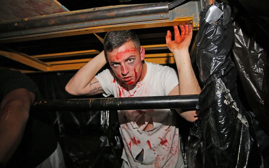 Pfc. Jonathan W. Pope Jr. acts as a caged zombie inside a haunted house Oct. 25 aboard Cherry Point, N.C. While driving, be sure to watch for zombies who have escaped their cage and are roaming the air station in search of candy today.