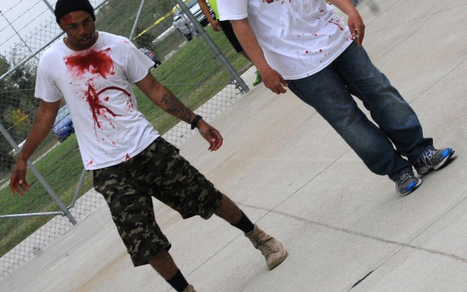 Soldiers from 4-5 ADA practice their zombie walking skills during the unit's zombie run at the Lightning Ranch at Fort Hood, Texas, on Oct. 26.