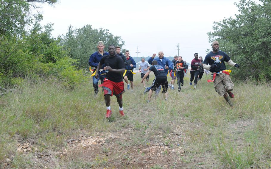 Soldiers and families from the 69th Air Defense Artillery Brigade participate in the zombie run at the Lightning Ranch at Fort Hood, Texas, on Oct. 26.