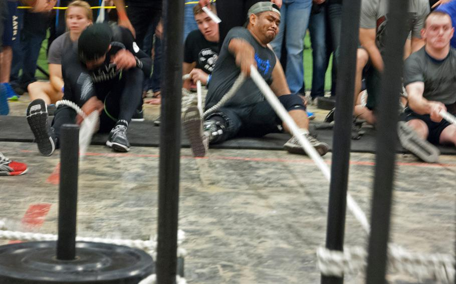 Army veteran Lyndon Sampang pulls weights toward him during the Working Wounded Games on Saturday, Nov. 2, 2013. The games were held in Vienna, Va.