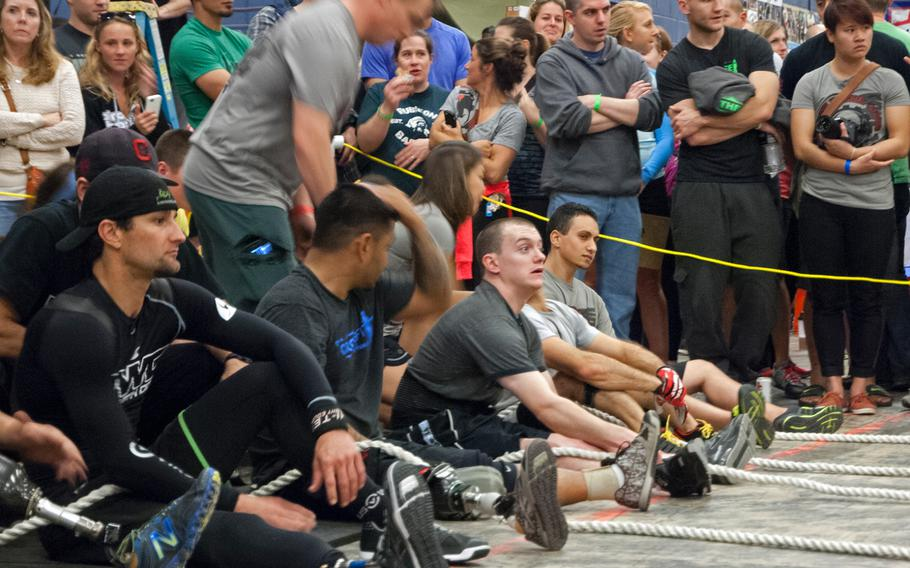 Athletes line up at the start of a competition on Saturday, Nov. 2, 2013, during the Working Wounded Games in Vienna, Va.