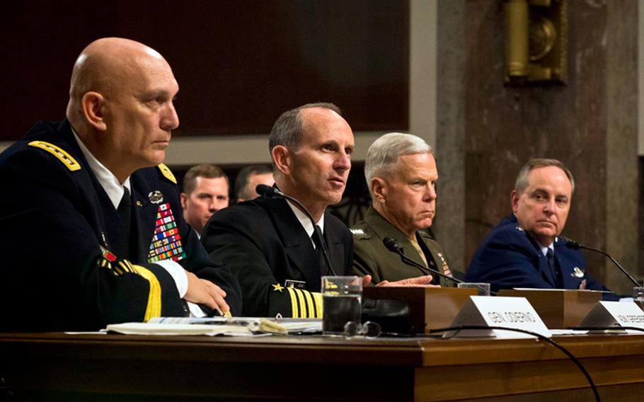 From left, Army Chief of Staff Gen. Raymond Odierno, Chief of Naval Operations Adm. Jonathan Greenert, Marine Corps Commandant Gen. James Amos and Air Force Chief of Staff Gen. Mark Welsh testify on Capitol Hill in Washington, on Thursday, Nov. 7, 2013, before the Senate Armed Services Committee on budget cuts to the military.