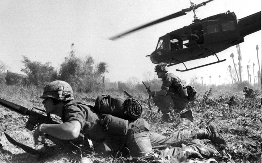 Maj. Bruce Crandall's UH-1D helicopter climbs skyward after discharging a load of infantrymen in Vietnam.
