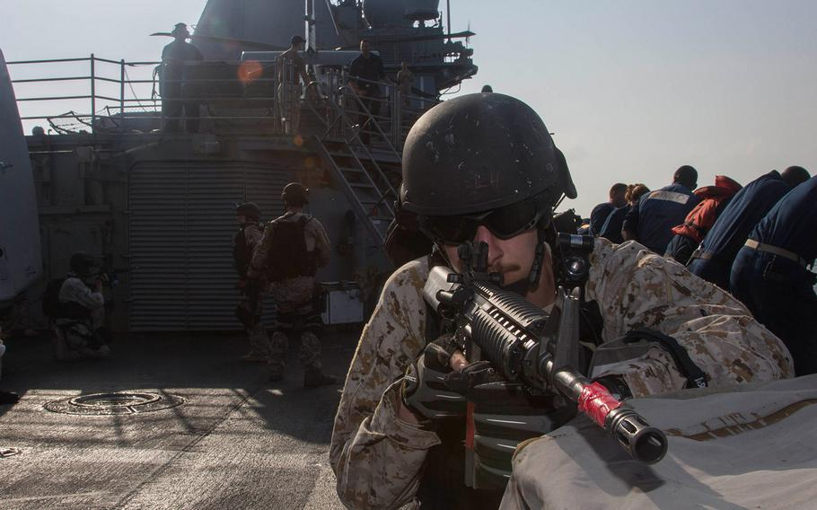 Electronics Technician 2nd Class Tristan McAnaney provides rear security during a VBSS exercise.