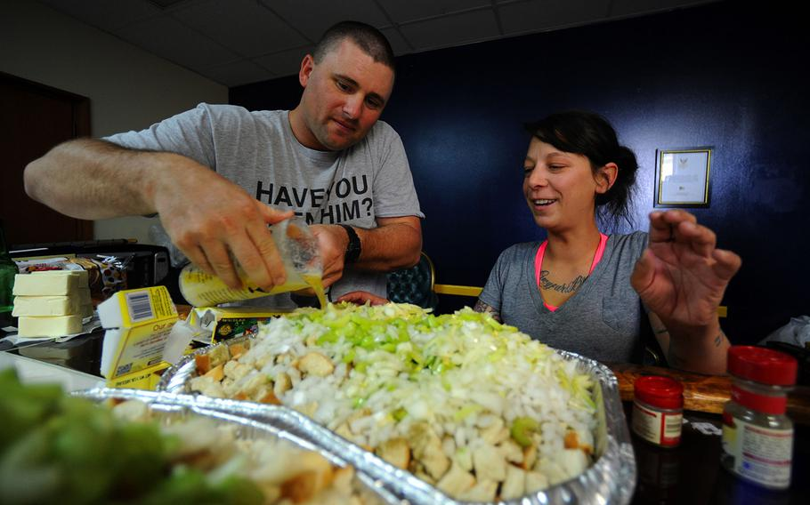 Brian Neilsen, left, and Sarah Hollister prepare stuffing for a Thanksgiving Day meal.