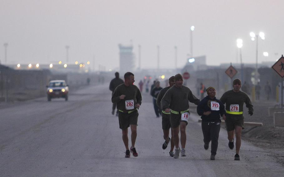 Servicemembers participated in a Thanksgiving day 5k run Camp Leatherneck, Afghanistan, Nov. 28. The Turkey Day fun run gave them the opportunity to build camaraderie through friendly competition.