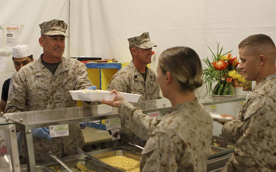 U.S. Marine Brig. Gen. James Lukeman, commanding general of 2nd Marine Division, serves a Marine in the chow hall at Camp Leatherneck, Afghanistan, Nov. 28. Even while deployed service members are still able to have a little taste of home by celebrating the holidays with a Thanksgiving meal.