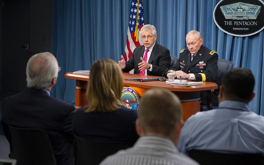 Secretary of Defense Chuck Hagel and Chairman of the Joint Chiefs of Staff Gen. Martin E. Dempsey brief the press at the Pentagon, Dec. 4, 2013.