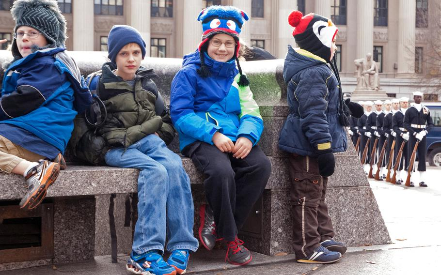 Children wait for the Pearl Harbor Remembrance Day ceremony to start in Washington, D.C.