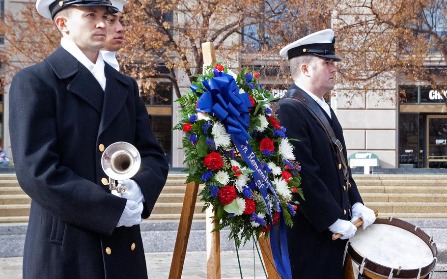 Sailors wait for the wreath laying during the Pearl Harbor Remembrance Day in Washington, D.C.
