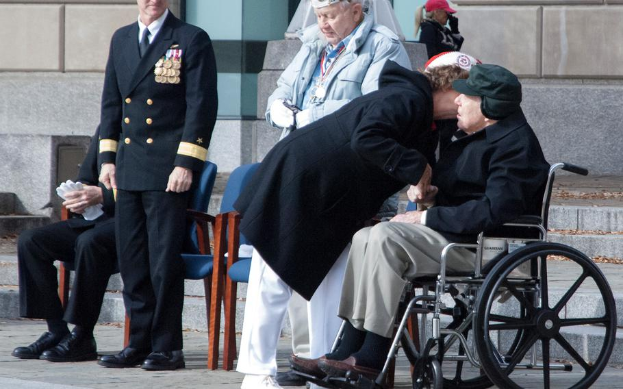 Lou Large leans in and gives Pearl Harbor survivor Major Albert Grasselli a kiss on the cheek after saying a few words to the crowd gathered for the Pearl Harbor Remembrance Day at the U.S. Navy Memorial on Dec. 7, 2013 in Washington, D.C.