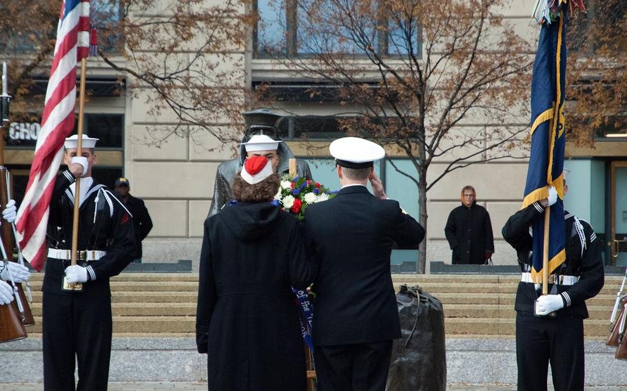 Lou Large helps to lay the wreath at the Lone Sailor during the Pearl Harbor Remembrance Day on Dec. 7, 2013.