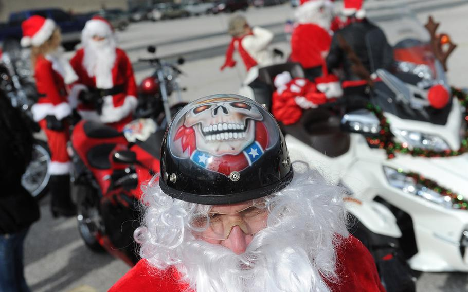 SANTA-TUDE | Larry Daniels joins over a dozen Santa Clauses as they ride their motorcycles to meet with and hand out stuffed animals to children in York, Pa., on Dec. 7, 2013.