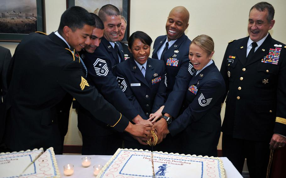 Six of the National Guard's eight 2013 Outstanding Soldiers and Airmen of the Year kick off the National Guard's 377th birthday celebrations by cutting a cake on Capitol Hill, Washington, D.C., Dec. 11, 2013. The birthday is today, December 13.