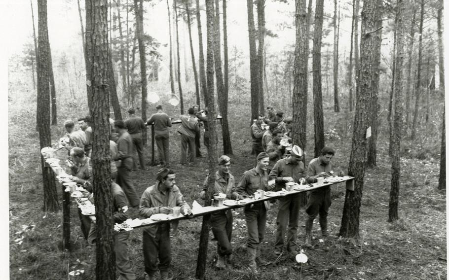 Soldiers from Headquarters, 44th Infantry Division, composed of elements from the New Jersey and New York National Guards, eat Thanksgiving dinner in the closing days of the Carolina Maneuvers, November 1941.