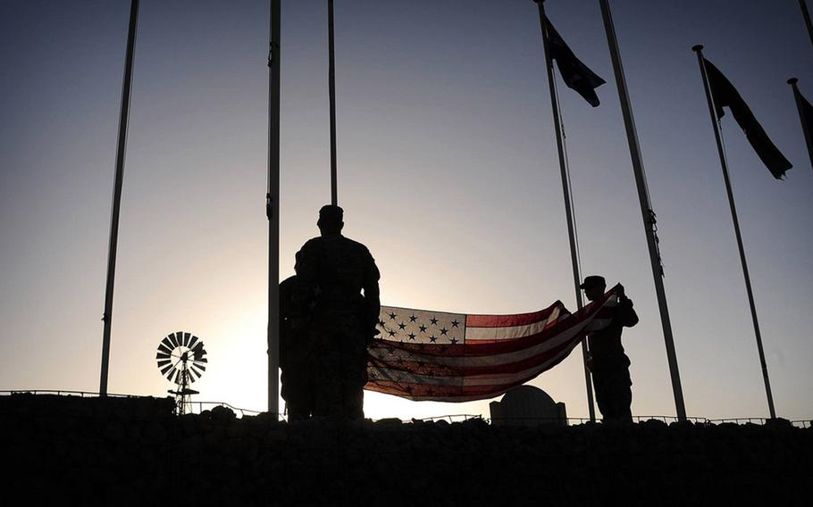 U.S. Soldiers with the 79th Infantry Brigade Combat Team, California Army National Guard, prepare to raise the American flag at Multinational Base - Tarin Kowt, Uruzgan province, Afghanistan, Aug. 5, 2013. The flags are replaced periodically due to wear from harsh Afghanistan weather conditions.
