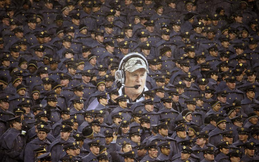 Army cadets hold a large photo of Army head coach Rich Ellerson during an NCAA college football game against Navy, on Saturday, Dec. 14, 2013, in Philadelphia. Navy won 34-7.